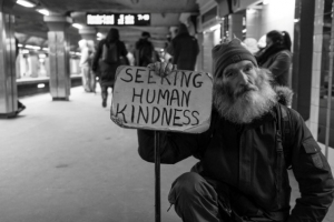 Homeless man in Langley holding a sign